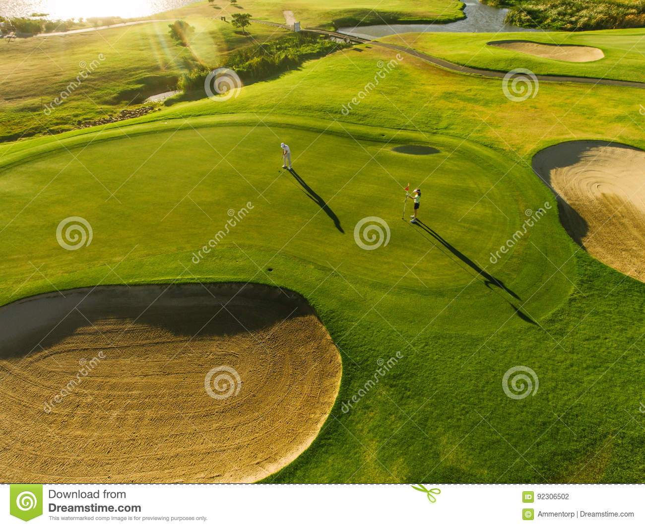 Download Players On A Green Golf Course Stock Photo - Image of vacations, green: 92306502