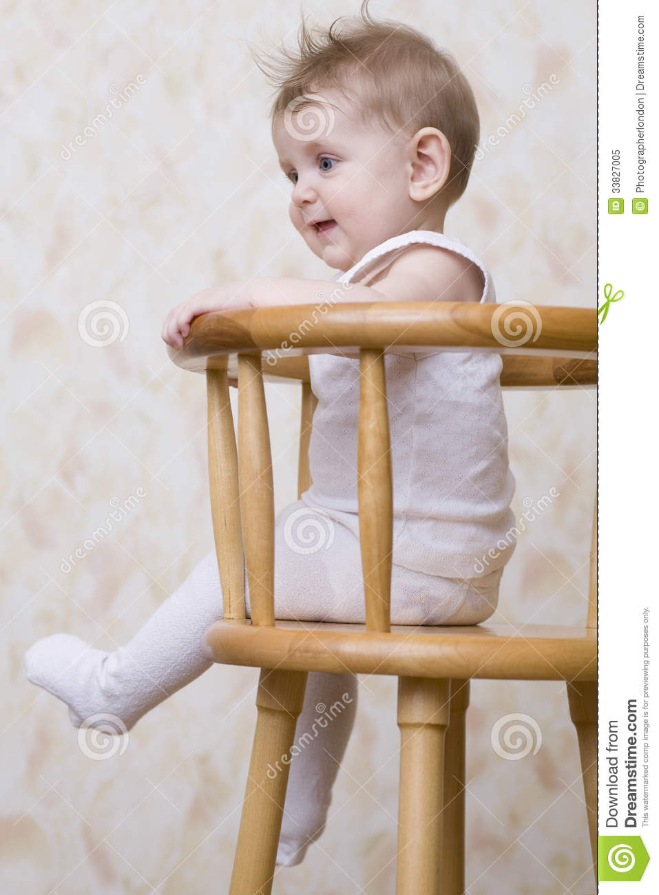 Playful baby boy sitting on high chair royalty free stock for Toddler sitting chair