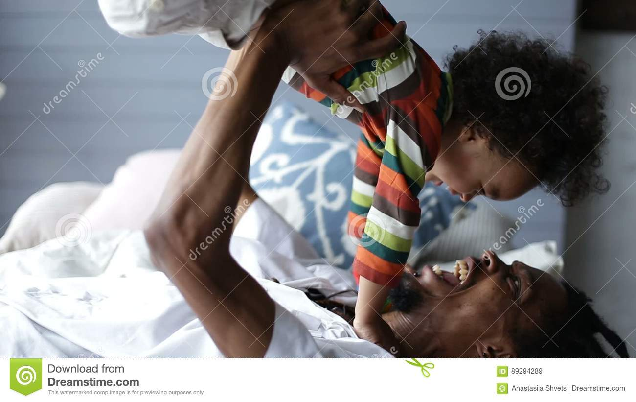 Playful Father Lifting Son Up While Lying On Bed Stock Video Video Of Parent Lifestyle 89294289
