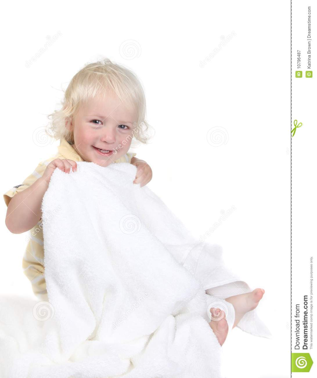 Playful Kid Holding a Bath Towel Smiling