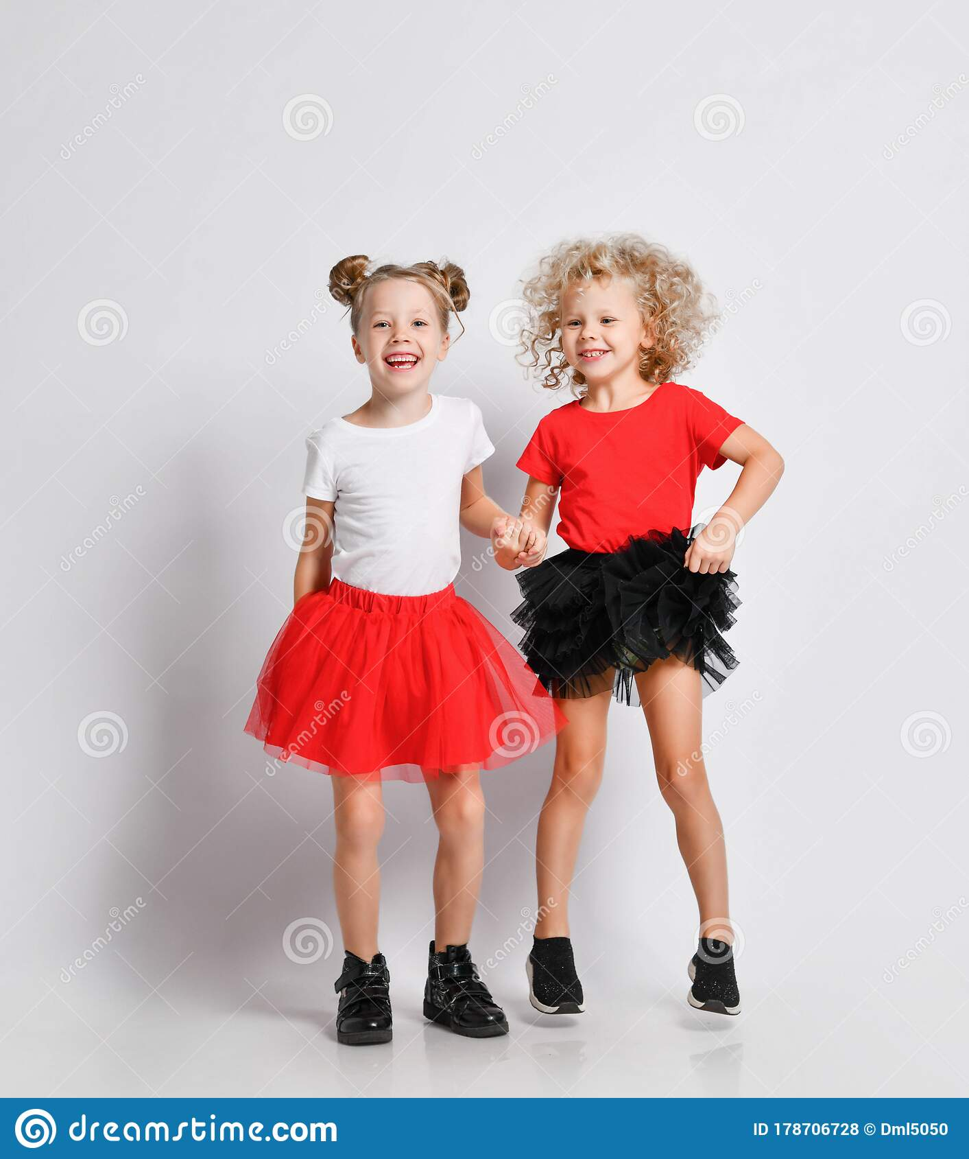 Playful Kids Girls In Skirts And T-shirts Are Jumping Playing Laughing  Screaming Having Fun Stock Photo - Image of girl, beautiful: 178706728