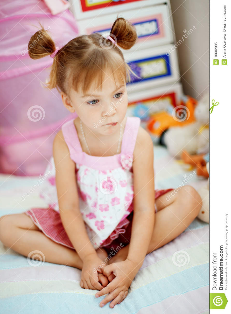 Pretty Little Girl Sitting Stock Photo - Download Image