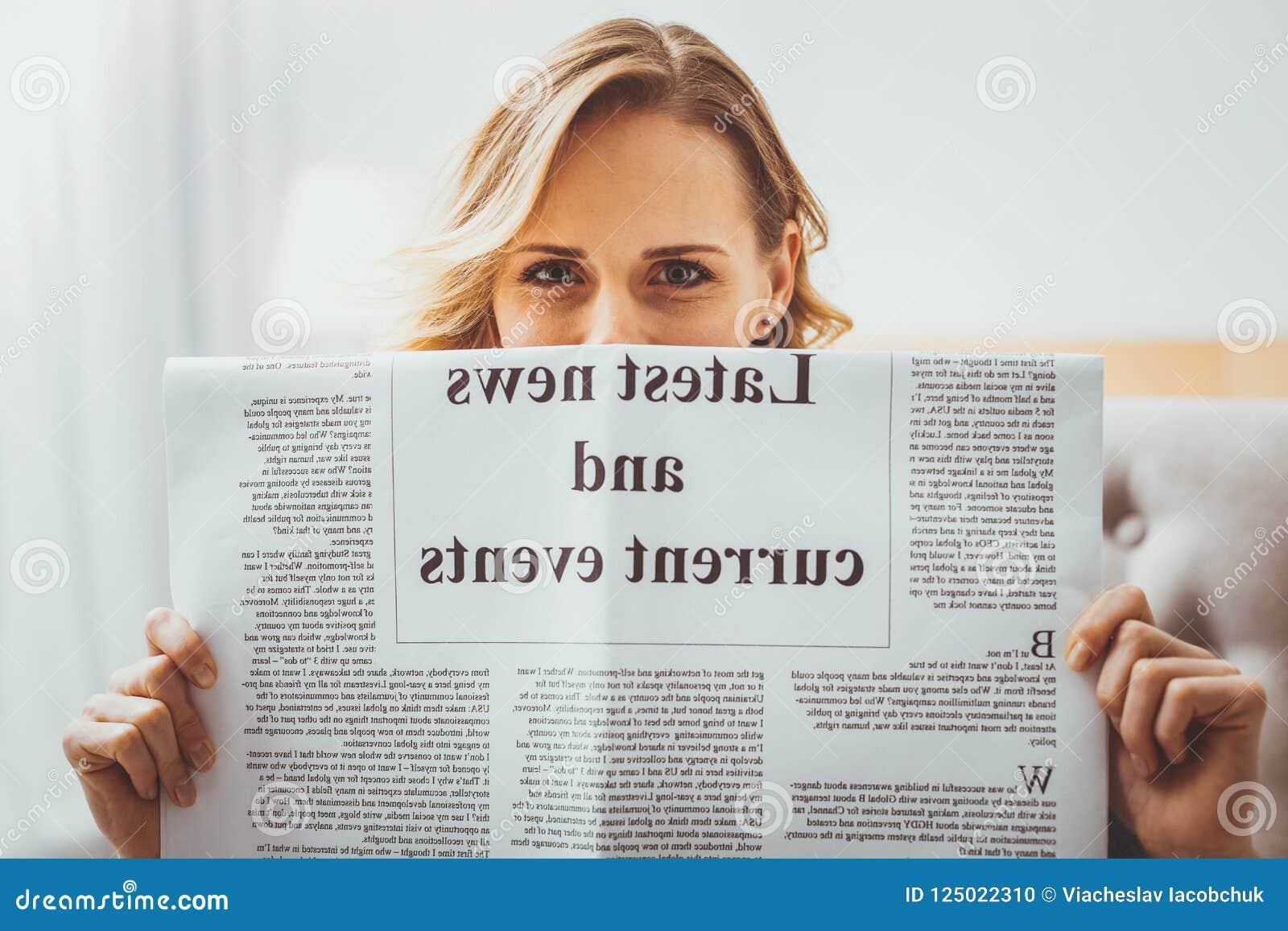 Beautiful Young Woman Demonstrating Favorite Article Stock