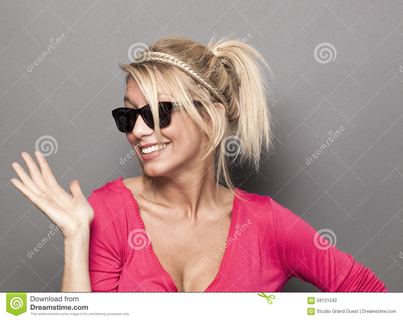 ce72fb3370a Summer or star sunglasses concept - sophisticated young blonde woman acting  like a star with smoked glasses