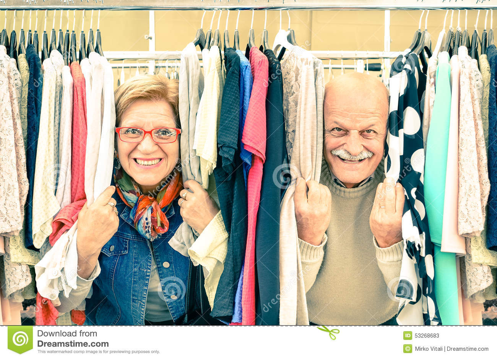 Playful senior couple at weakly flea market