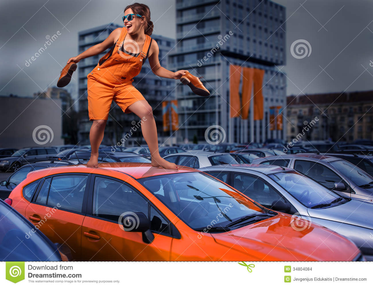 https://thumbs.dreamstime.com/z/playful-stylish-girl-orange-overalls-standing-car-roof-parking-lot-unique-person-young-dressed-barefoot-top-34804084.jpg