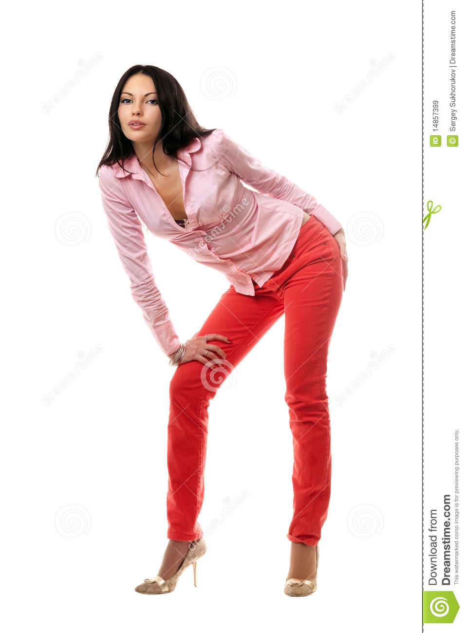 Playful young brunette in red jeans