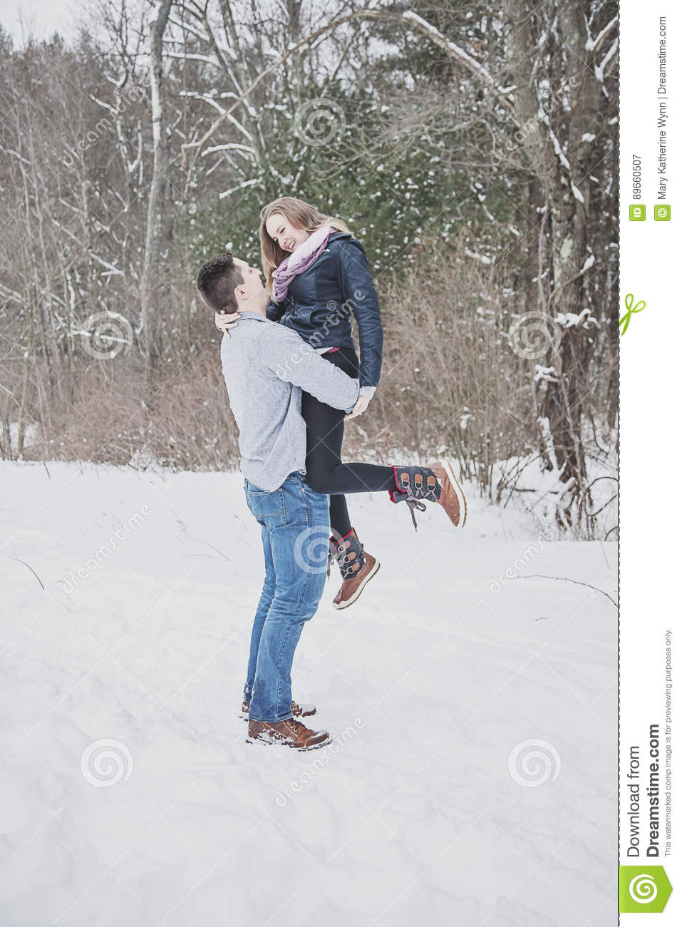 Playful young couple outdoors in winter