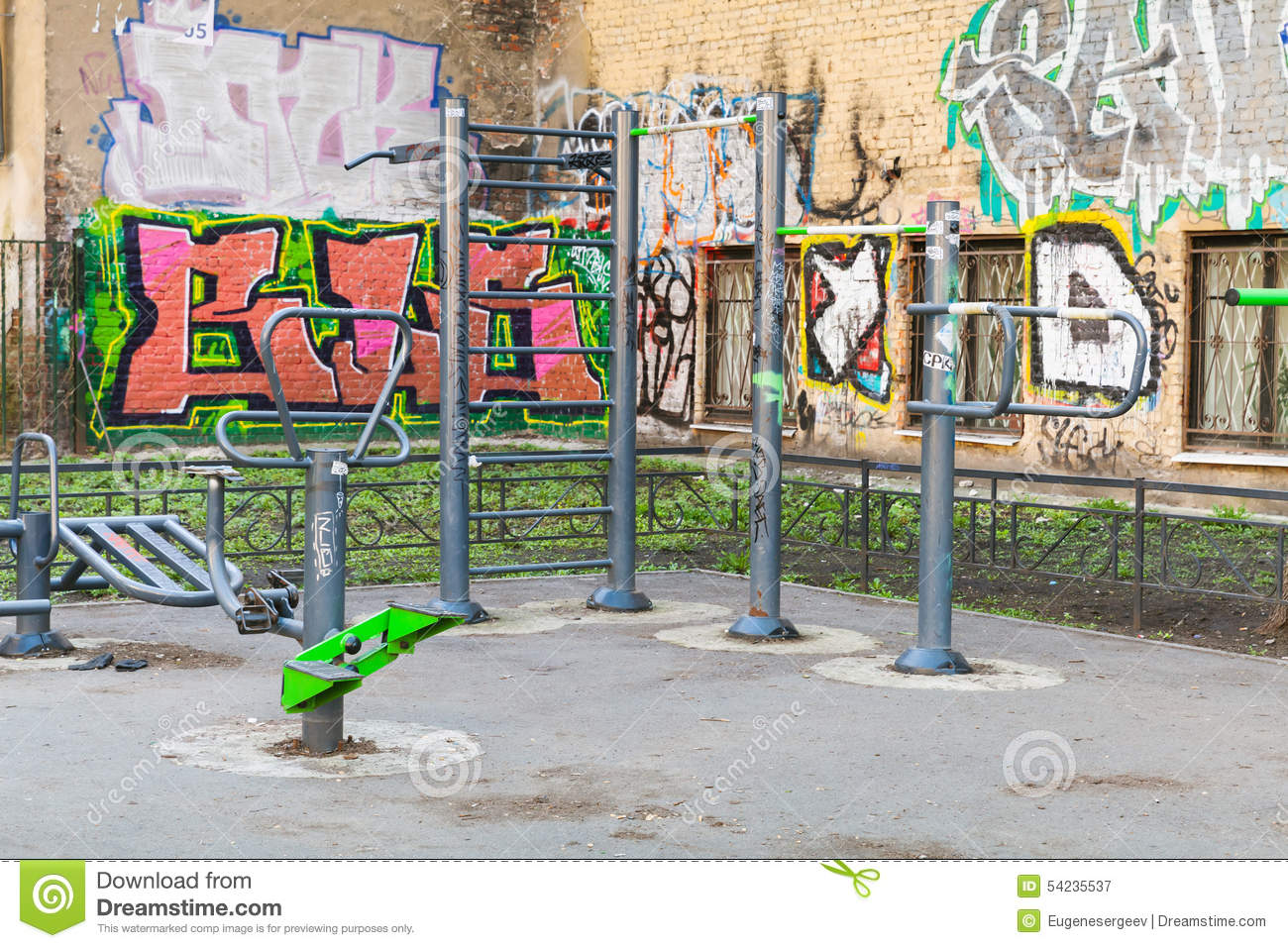 playground with fitness equipment and chaotic graffiti editorial photography image 54235537. Black Bedroom Furniture Sets. Home Design Ideas