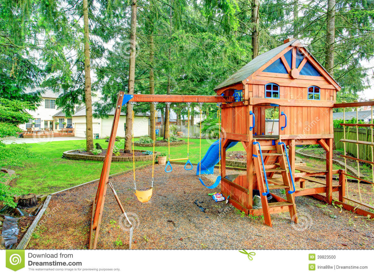 Best Backyard View : playground with swings, chute and small cute house with stairs