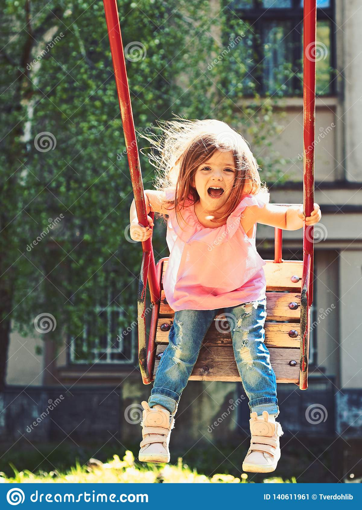 0be4827b5 Playground in park. Small kid playing in summer. Happy laughing child girl  on swing. romantic little girl on the swing, sweet dreams. childhood  daydream . ...