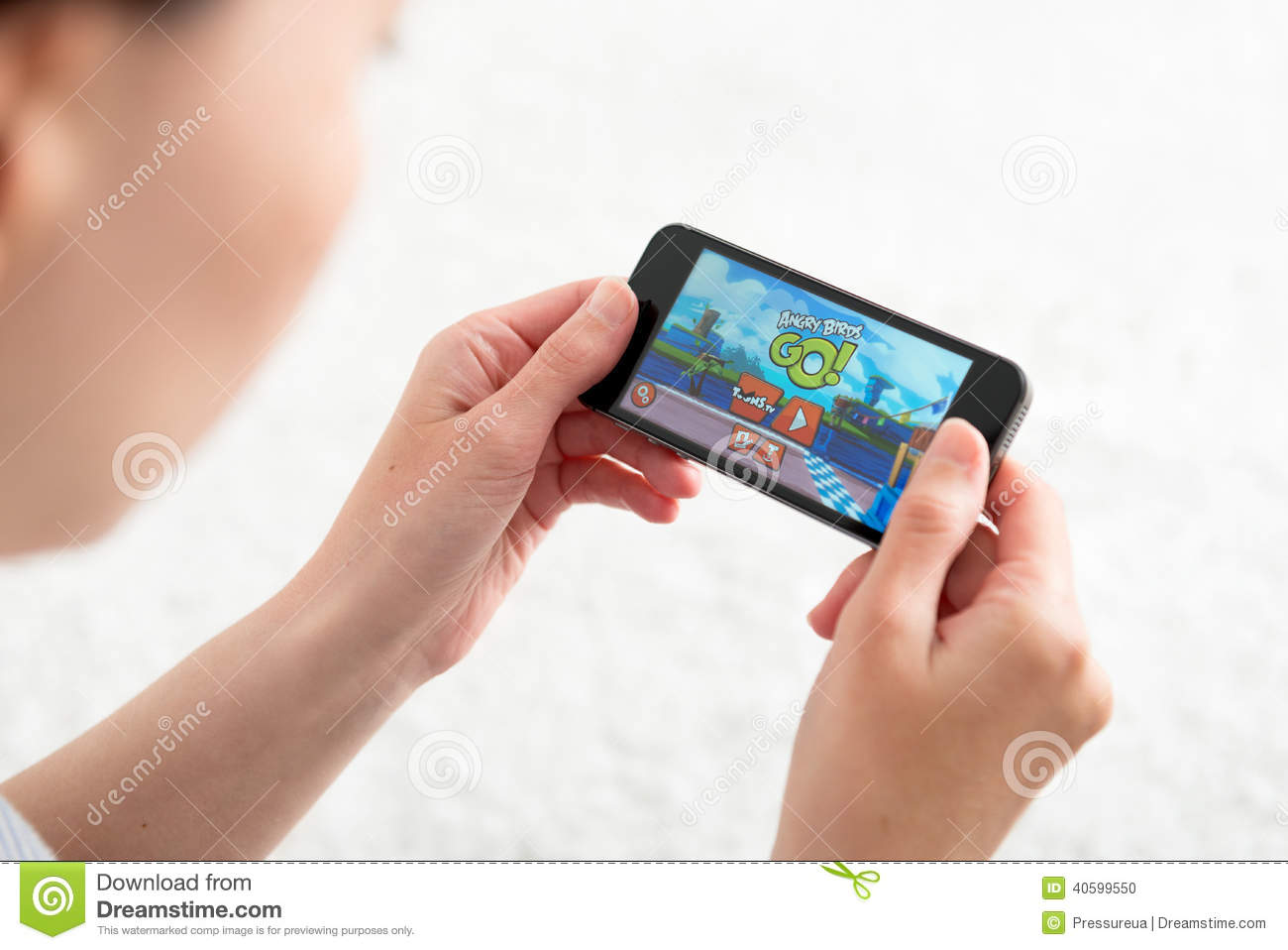 playing angry birds go mobile game editorial image   image
