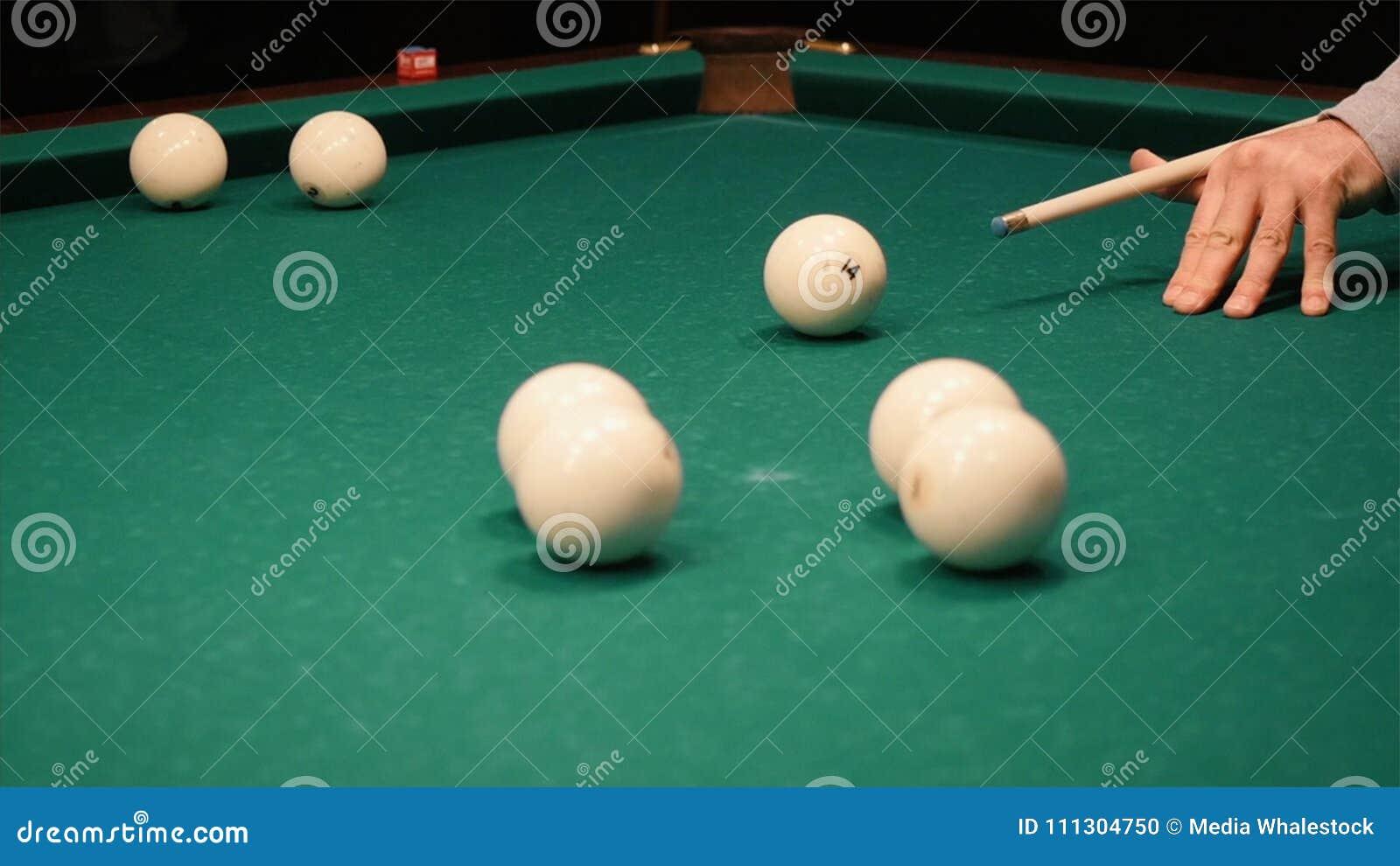 Playing billiards. Clip. Blowing a cue on the ball, the ball hit the pocket, the ball did not hit the pocket, billard
