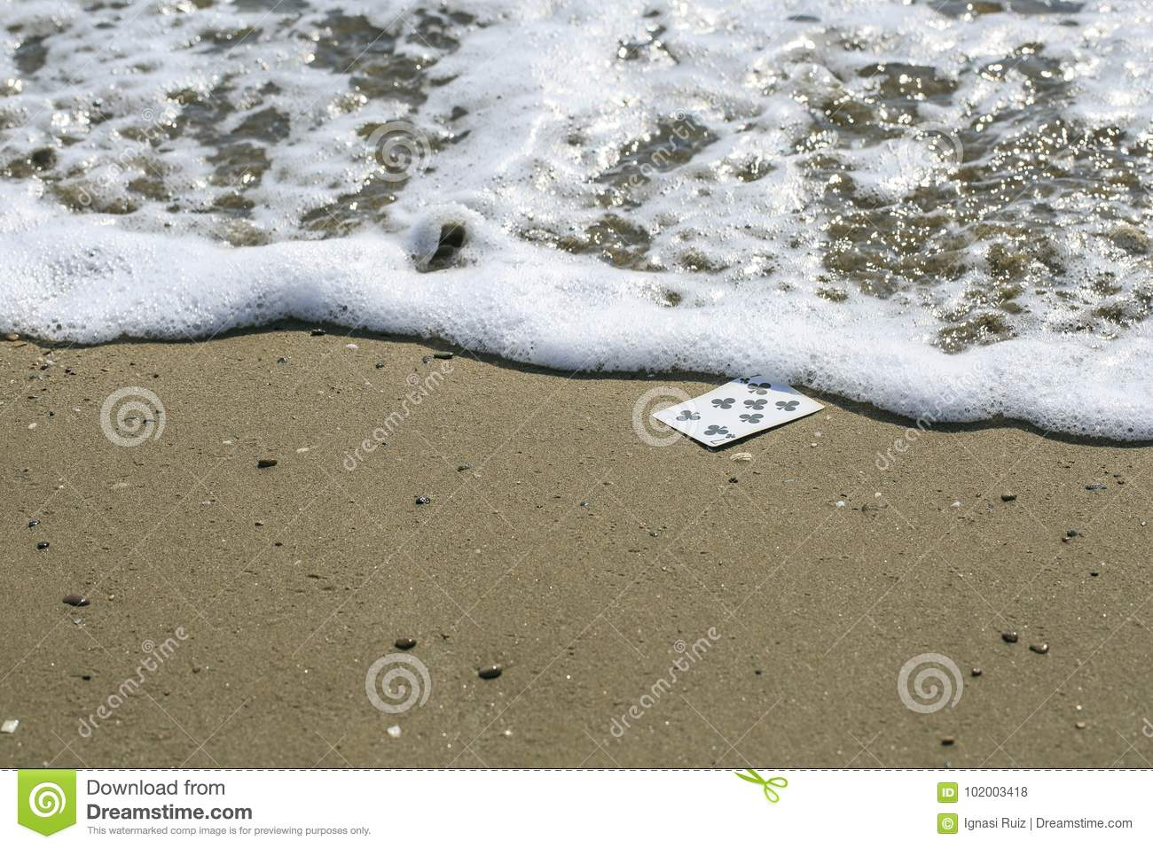 Playing cards in the beach
