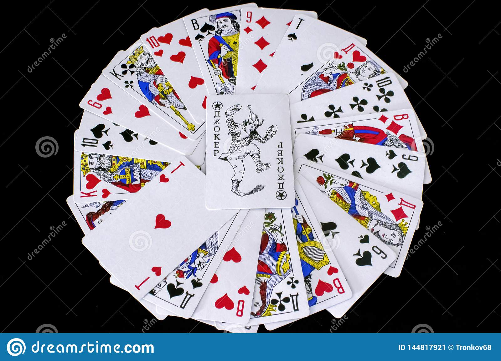 Playing cards on black background.