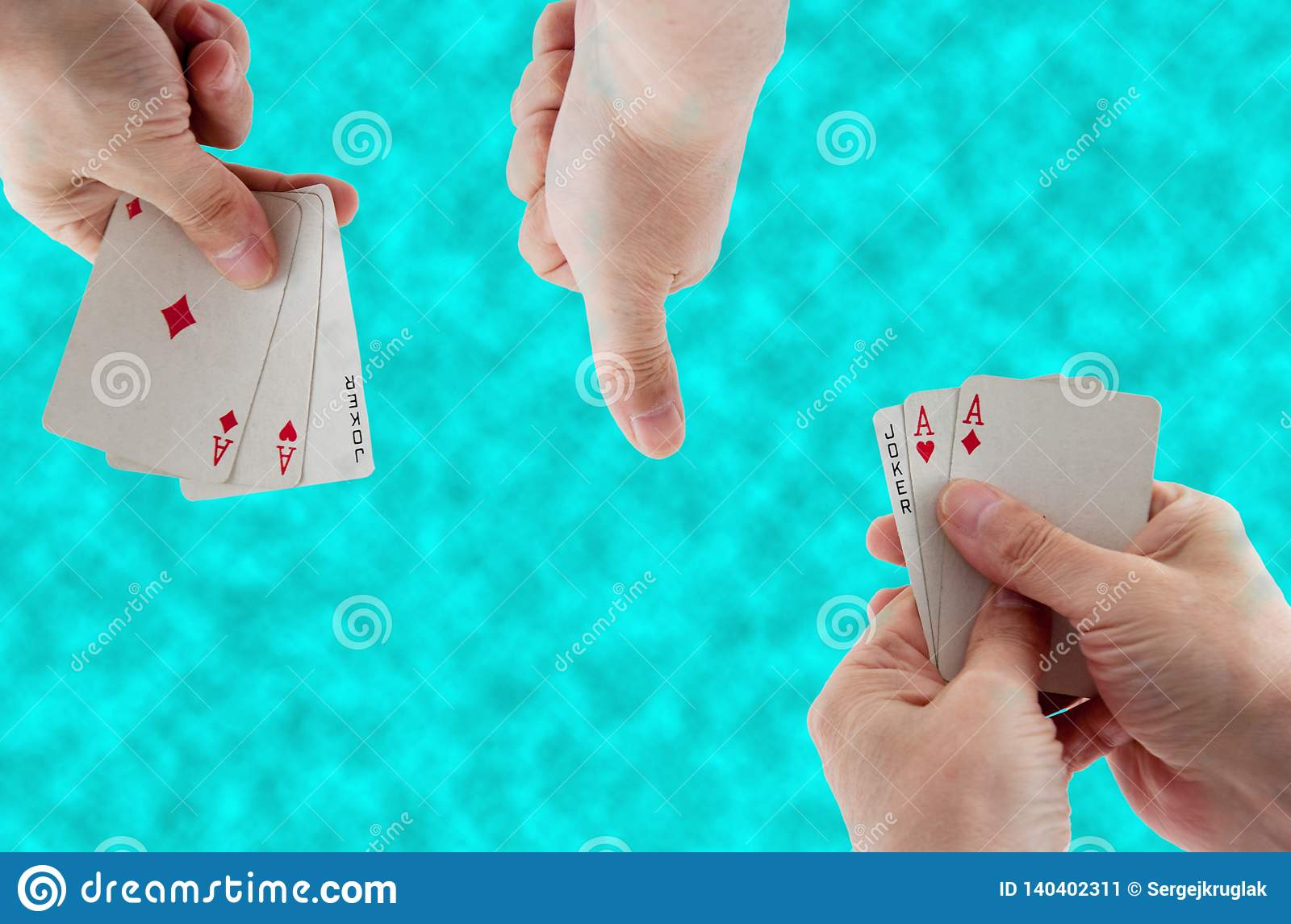Playing cards in hand on the background of water