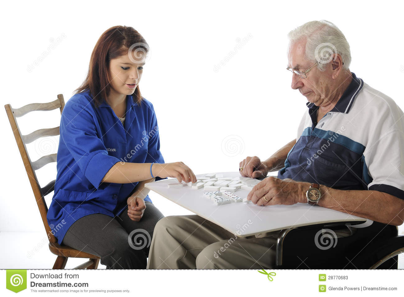Playing Games With The Elderly Stock Image - Image of volunteer