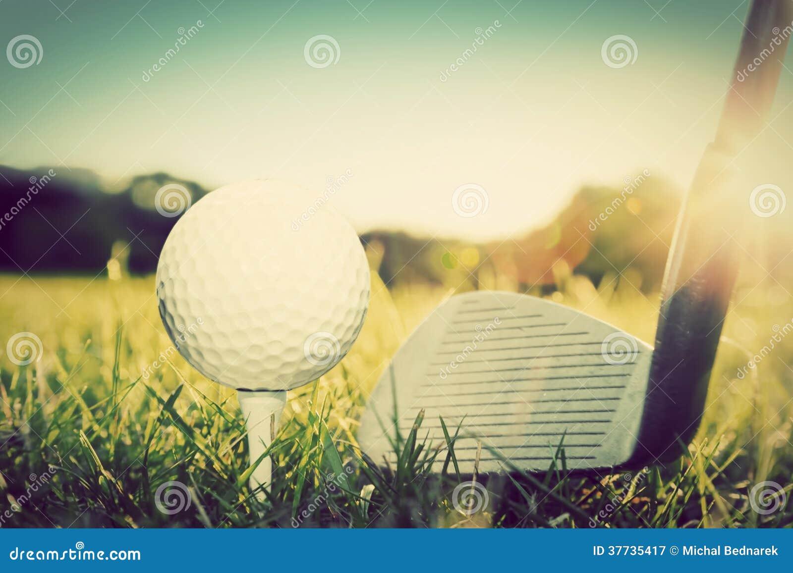Playing golf, ball on tee and golf club