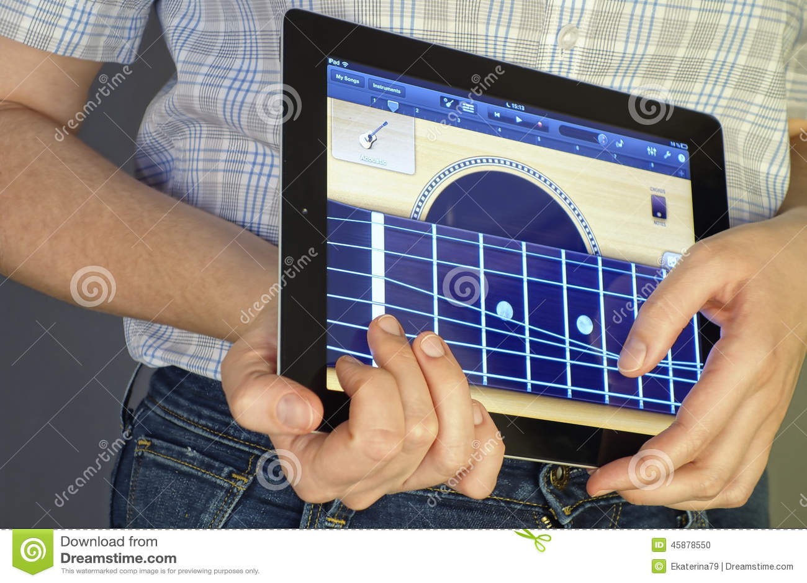 Playing guitar on Ipad editorial image  Image of garage - 45878550