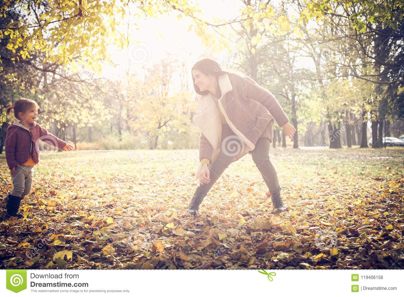 Playing in nature. Autumn sunny day.