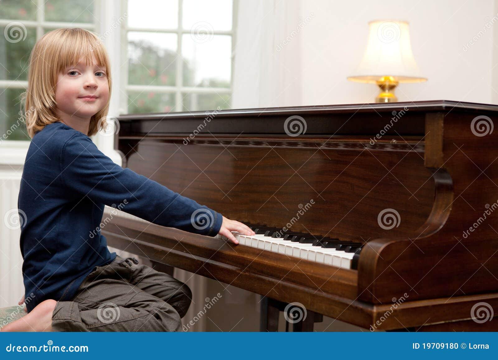 Playing piano music, boy Child instrument