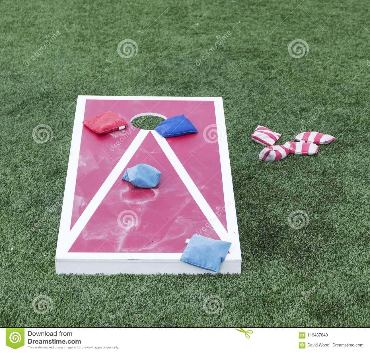 Red and white cornhole game
