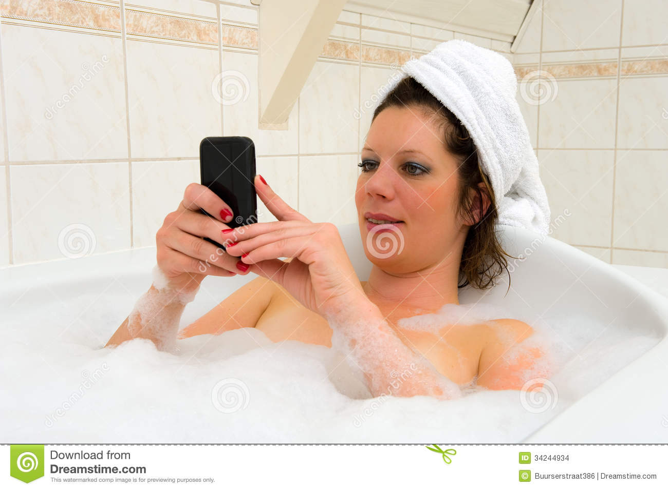 Playing with smartphone in bath stock images image 34244934 for Bathroom hot images