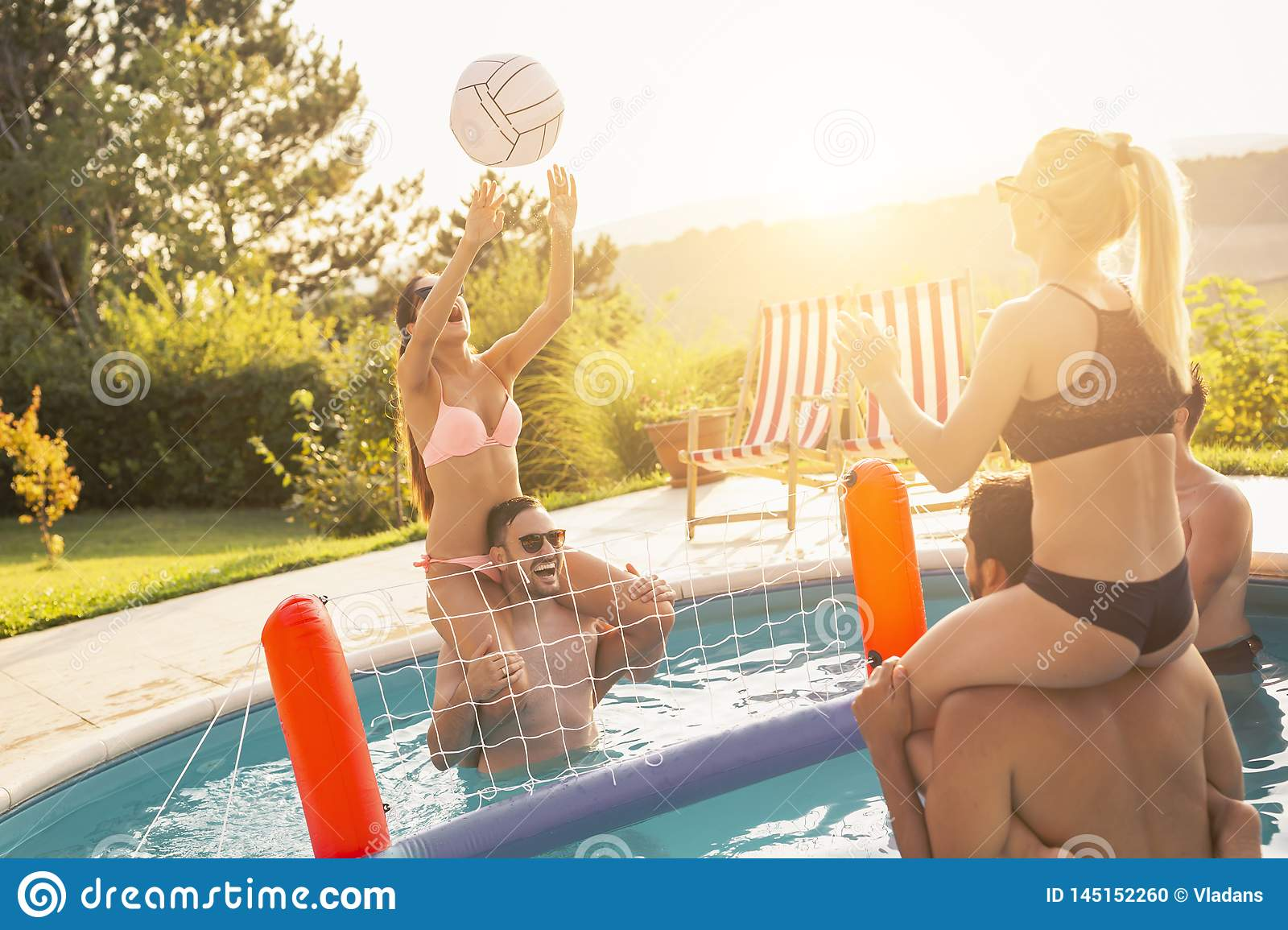 Playing volleyball in a swimming pool