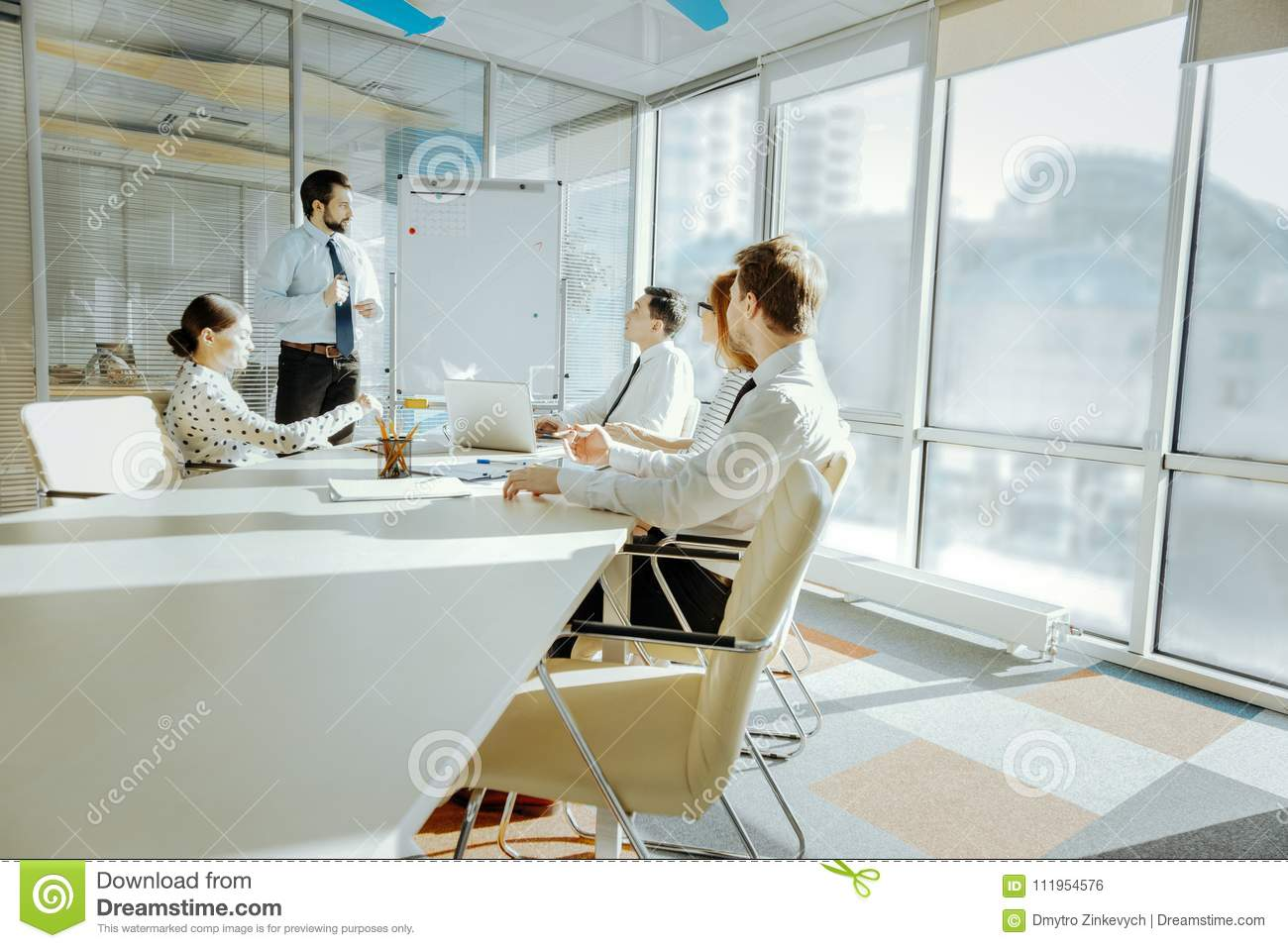 Pleasant Pleasant Colleagues Listening To Report In Conference Room Home Interior And Landscaping Ponolsignezvosmurscom