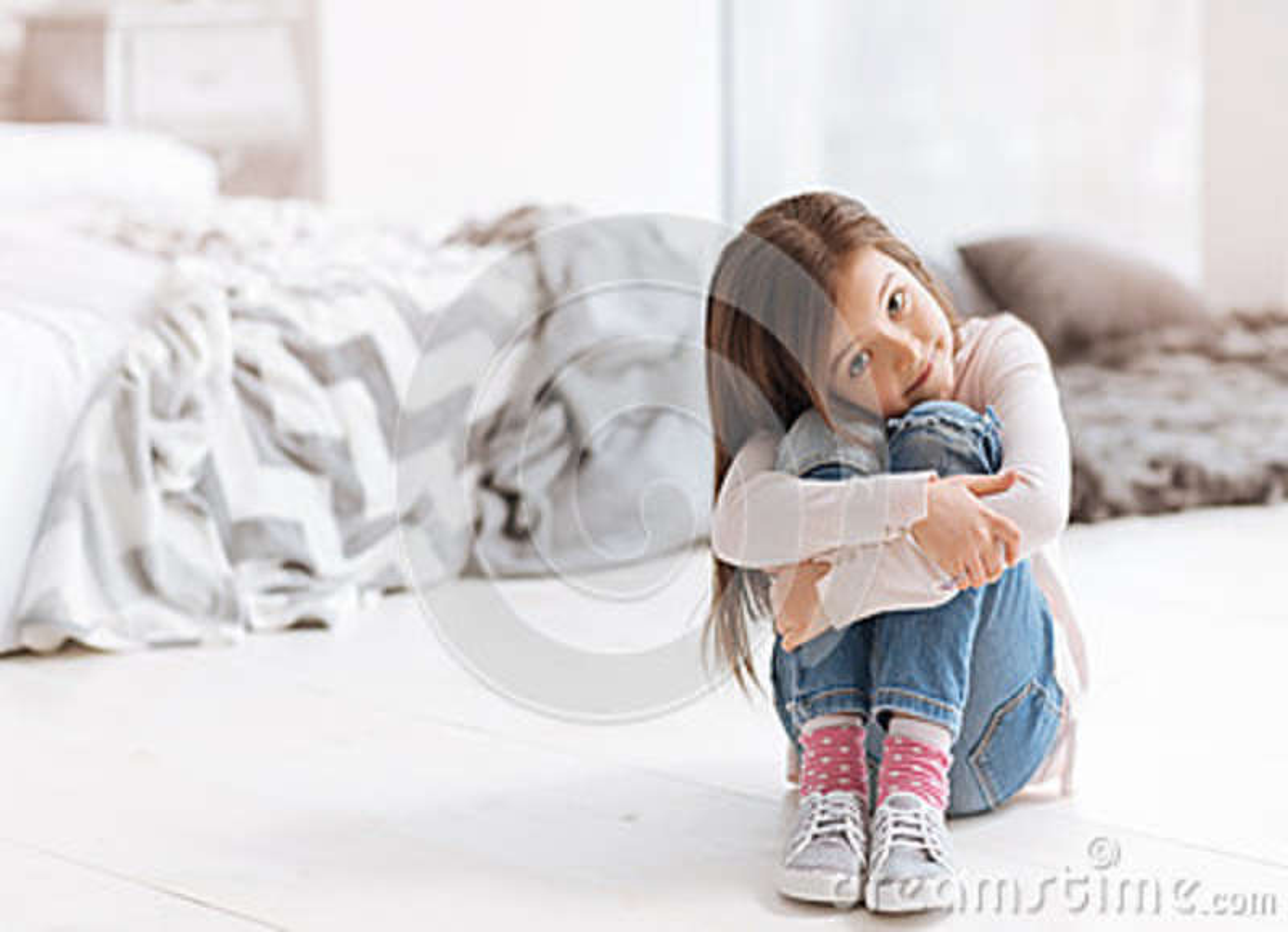 Pleasant cute girl sitting on the floor