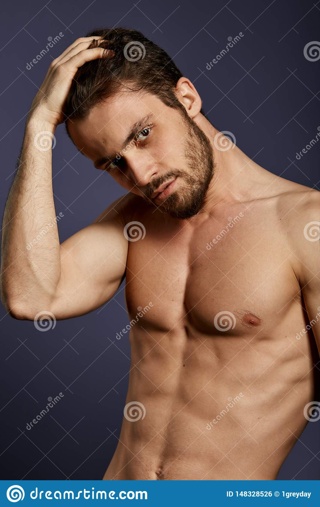 Pleasant good looking man showing his perfect torso, body