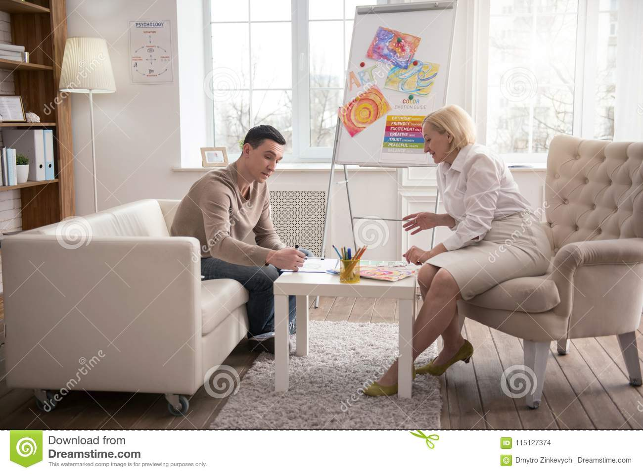 Pleasant Mature Psychologist Proposing Art Therapy Stock