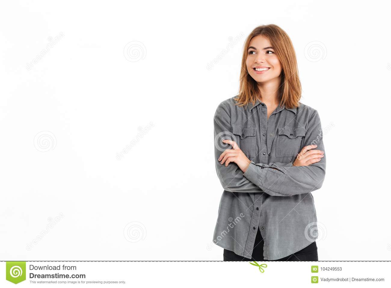 Pleased brunette woman in shirt with crossed arms looking aside