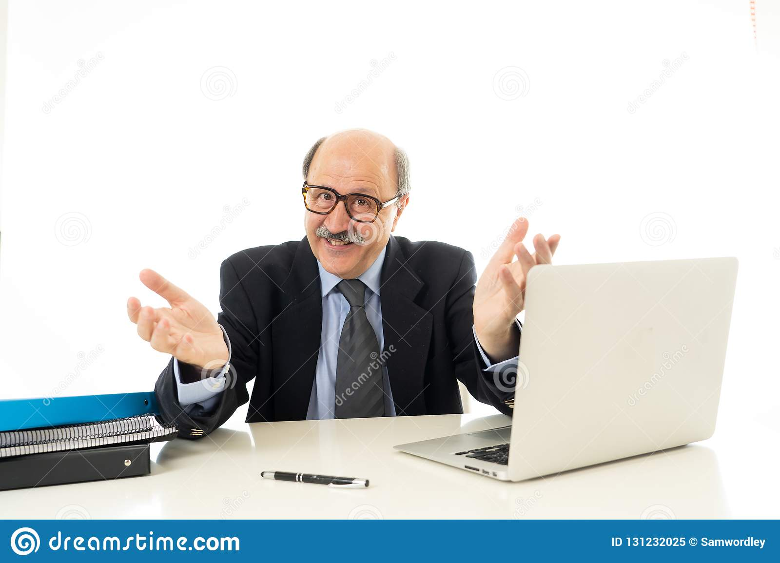 Pleased mature business man in his 60s working on laptop confident of success