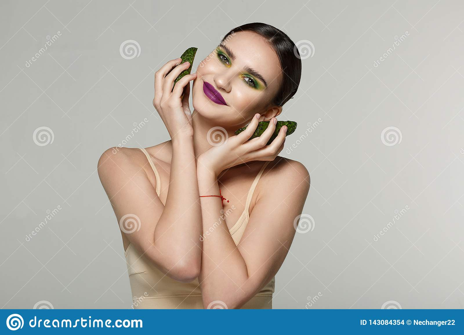 Pleasent smiling girl with perfect skin leads healthy lifestyle