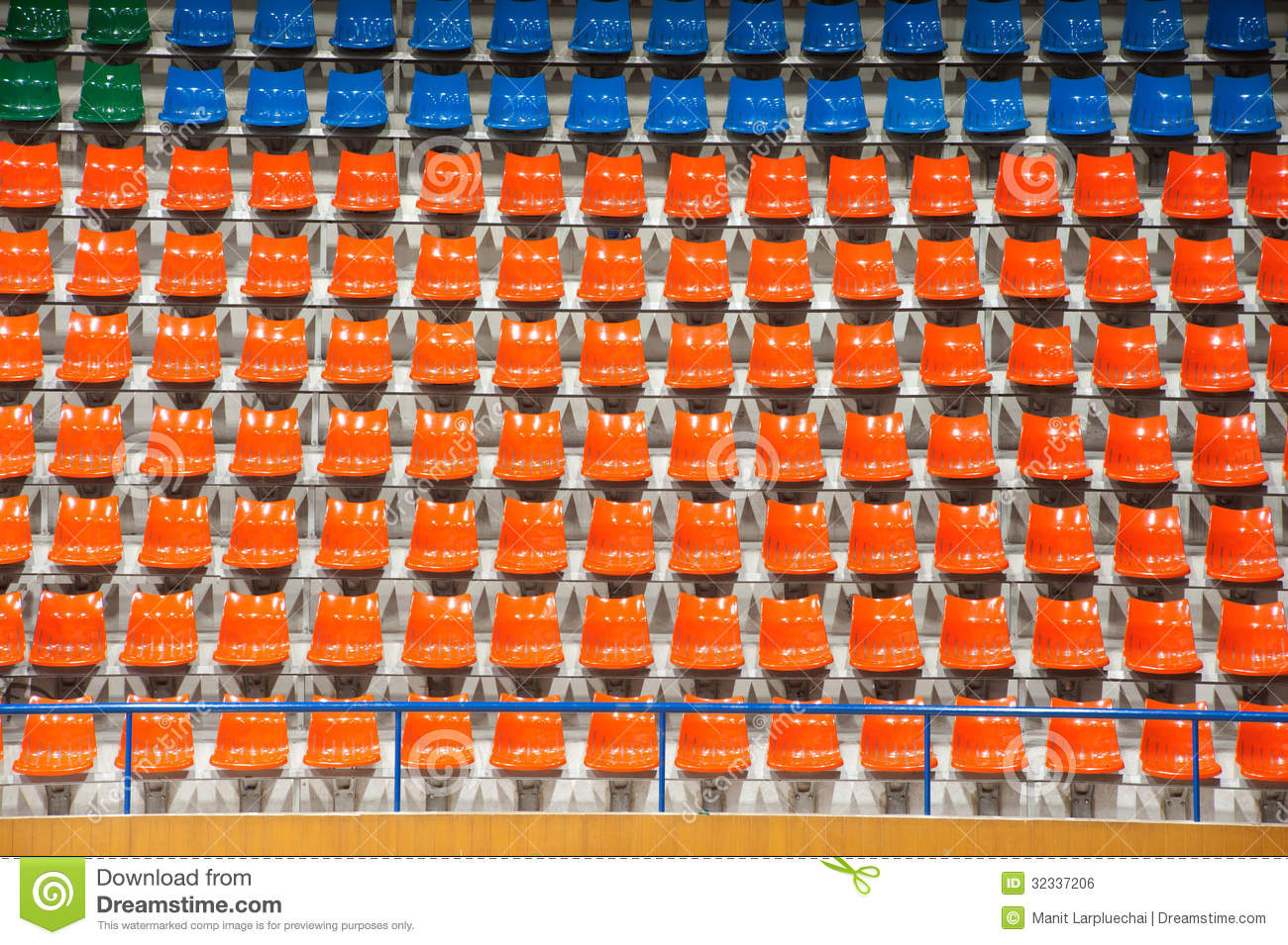 plenty of orange and blue plastic seats at stadium   stock photo