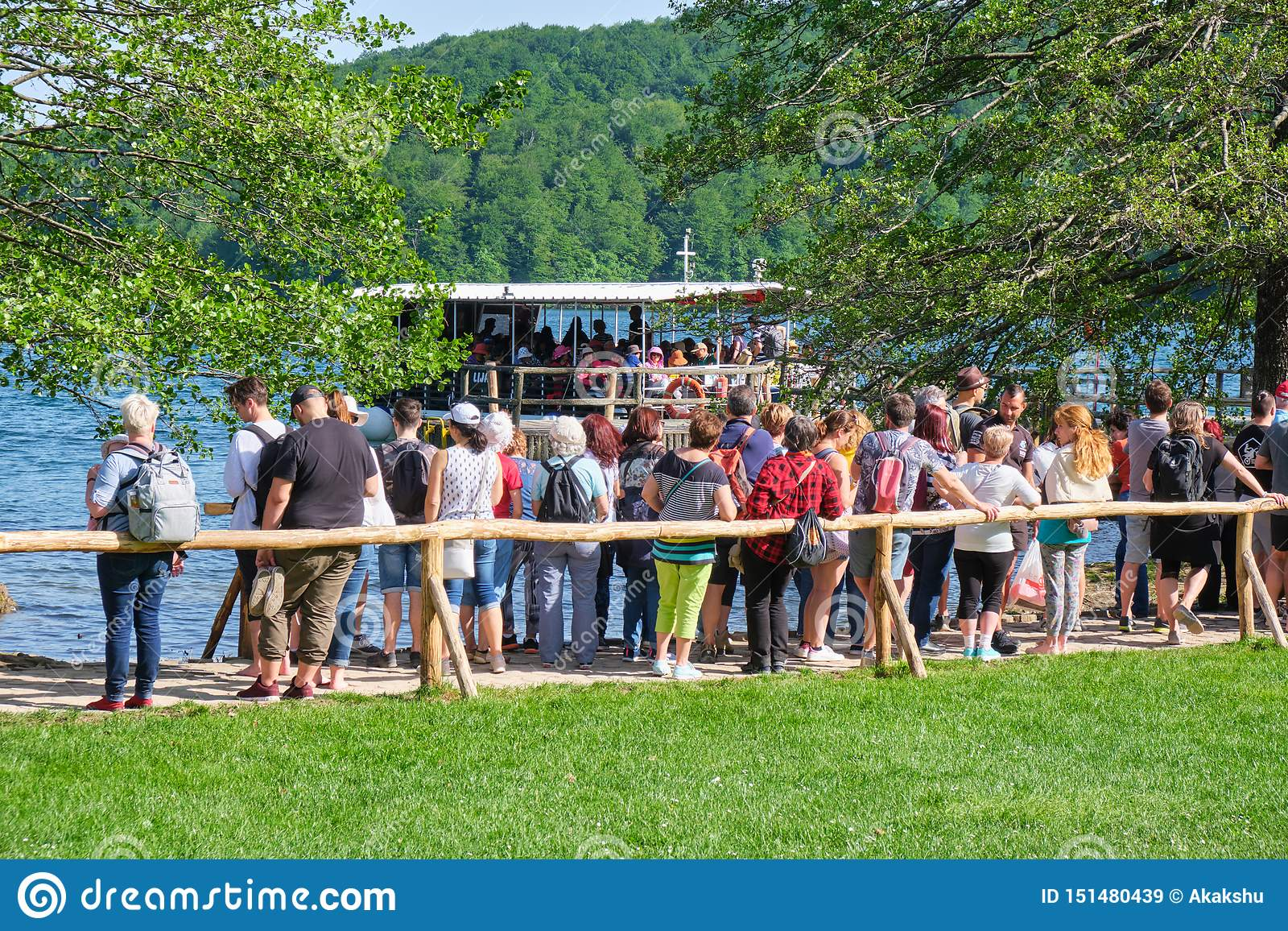 Long queue of people waiting for the electric boat to cross Kozjak Lake Jezero Kozjak. Popular touristic destination in Croatia.
