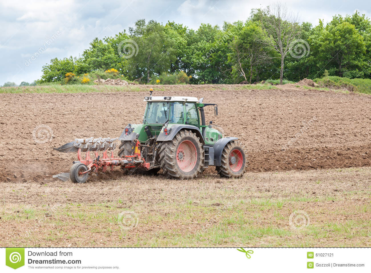 Tractor In Field Planting : Ploughing an agricultural field for planting stock photo