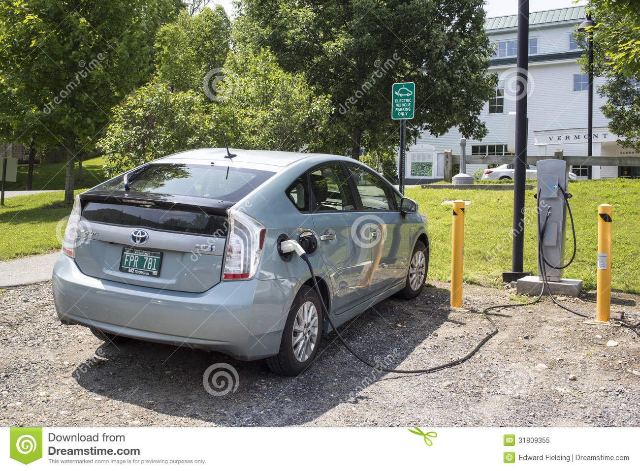 Plug in hybrid at electric car station editorial image for Vermont motor vehicle laws