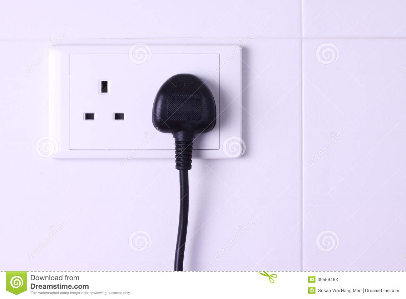 Plugged In Socket Against White Tiles Background Stock