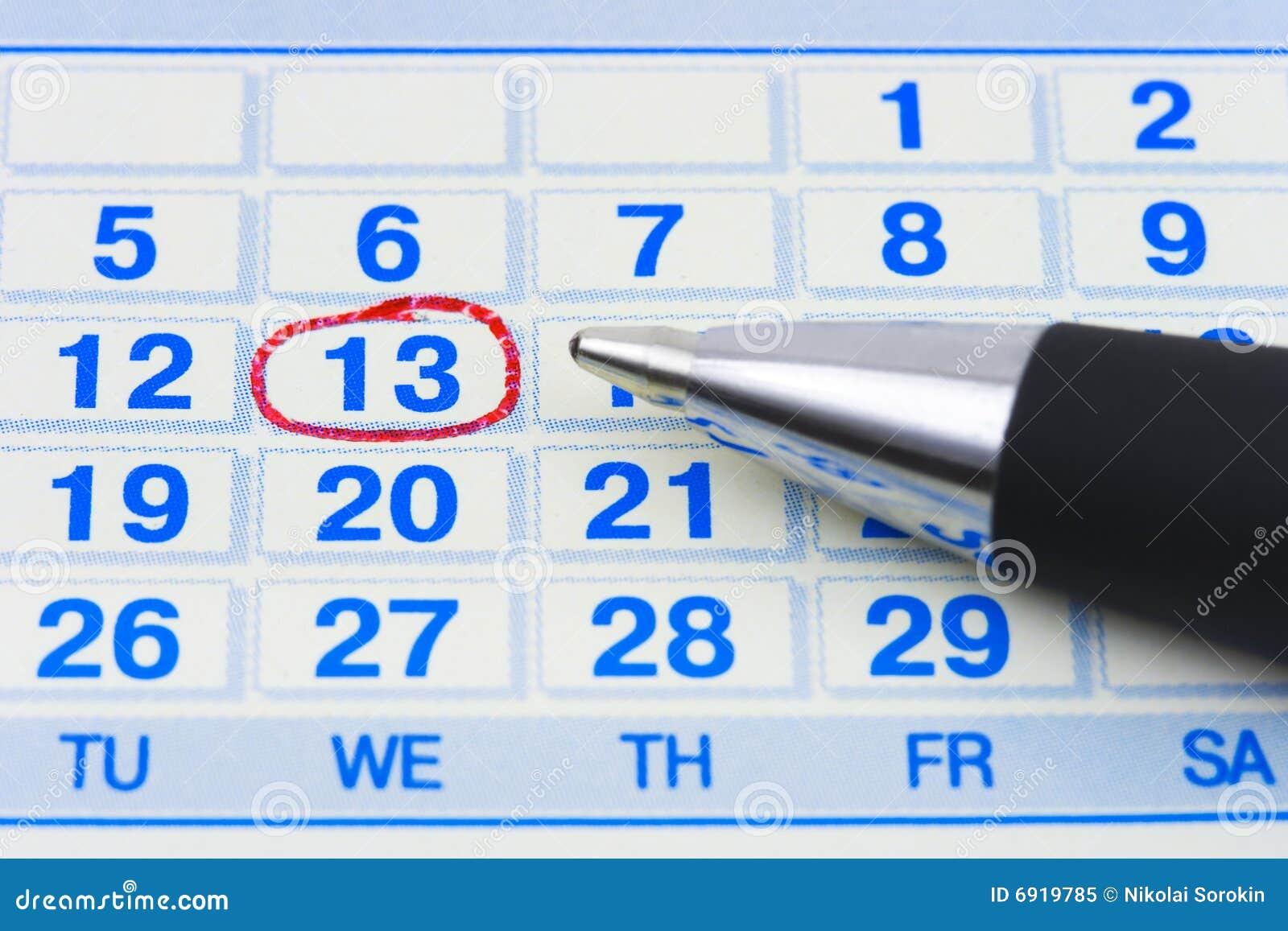 Pluma y calendario