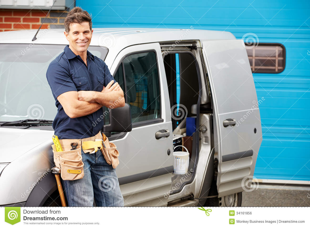 Plumber Or Electrician Standing Next To Van Royalty Free