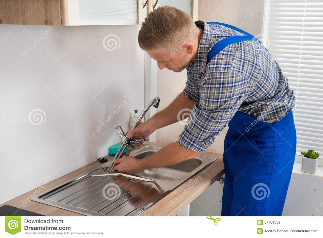 Plumber Fixing Faucet In Kitchen Sink Stock Image - Image of ...