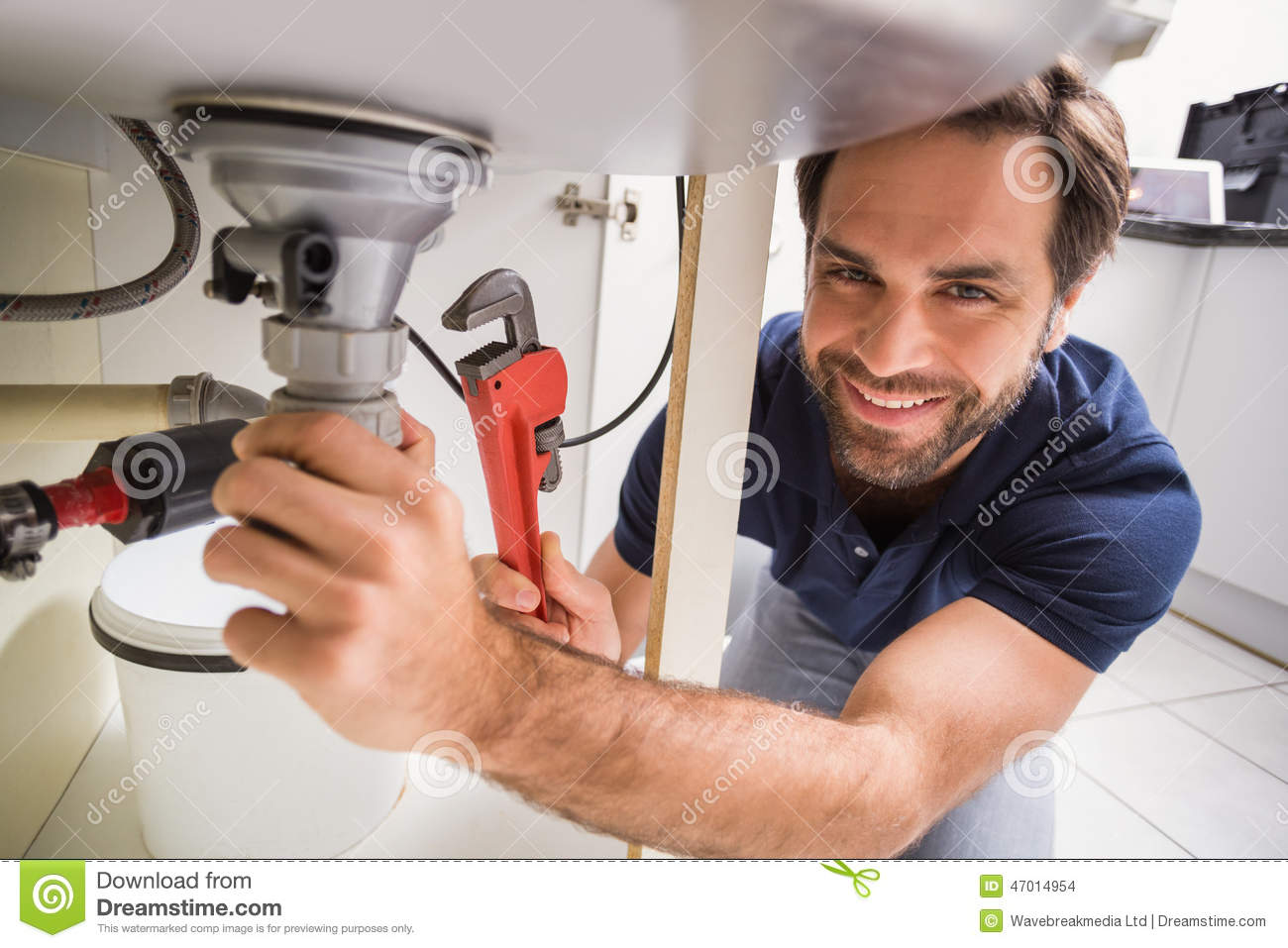 plumber-fixing-under-sink-kitchen-47014954.jpg