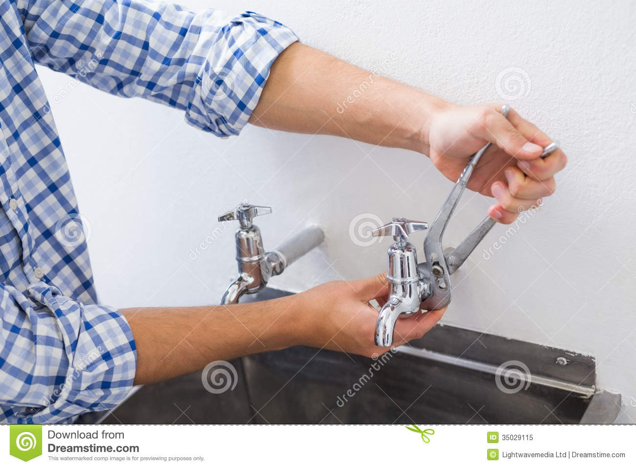 Plumber Hand\'s Fixing Water Tap With Pliers Stock Image - Image of ...