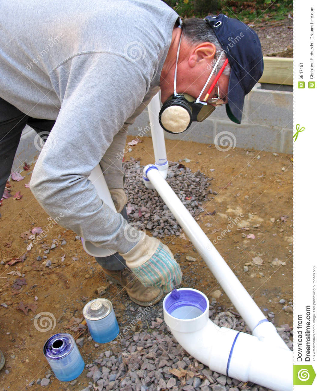Plumber joining plastic pipes stock image image of odor for Plastic plumbing pipes