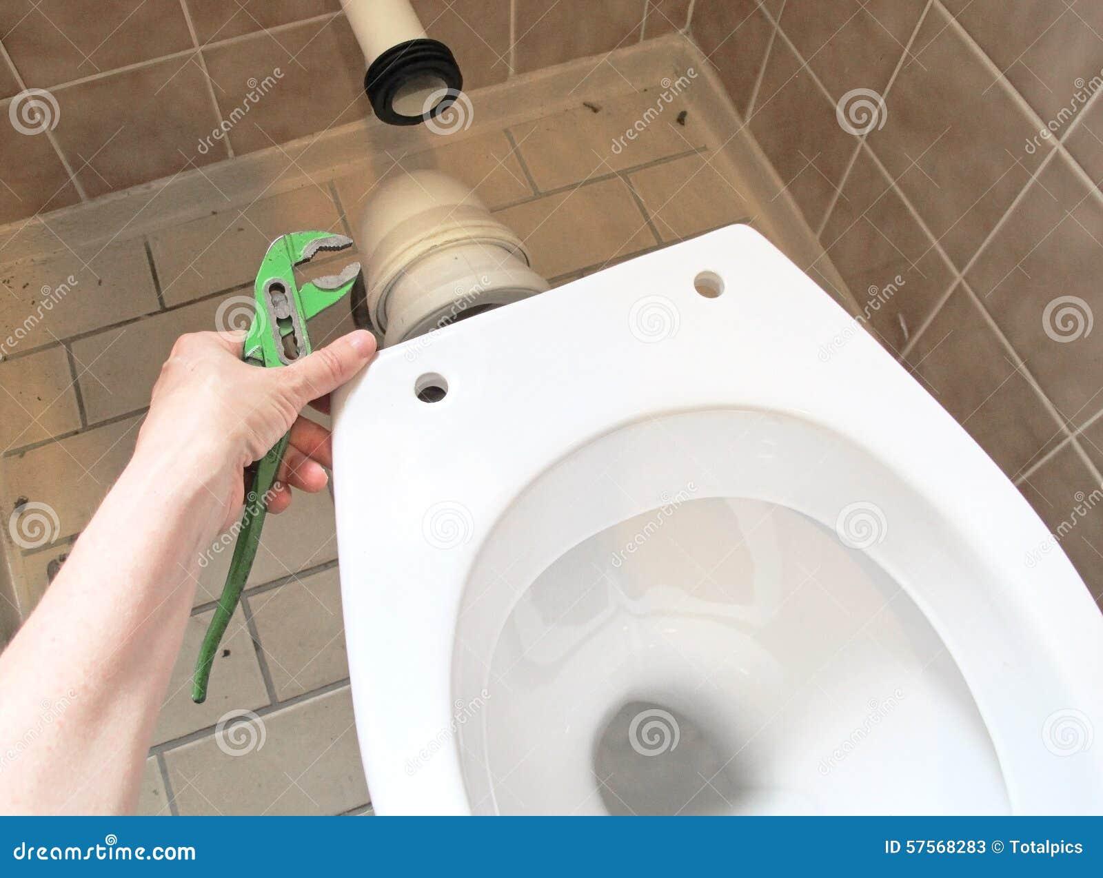Plumber and toilet bowl stock image. Image of repair - 57568283