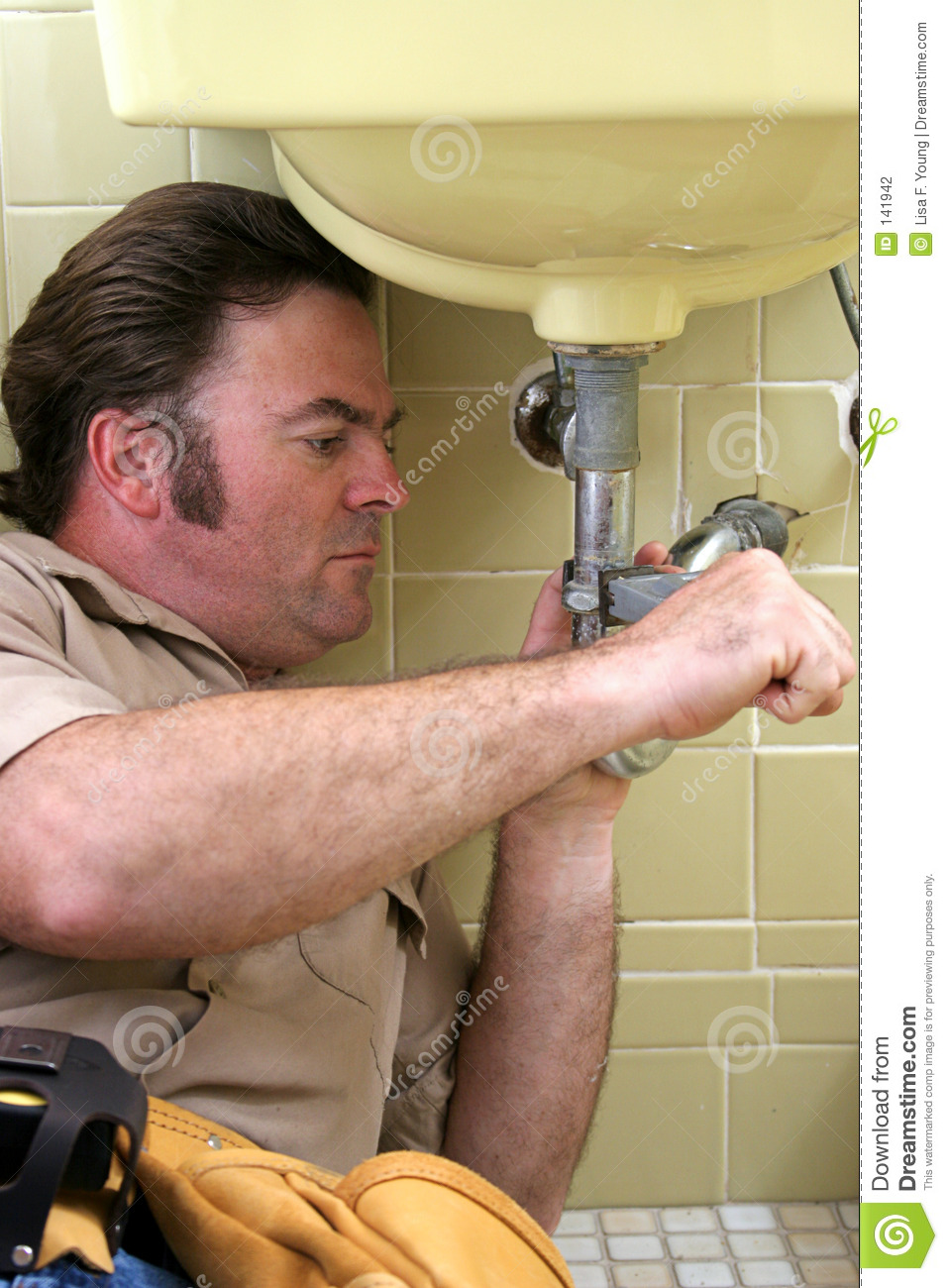 plumber-using-pipe-wrench-141942.jpg