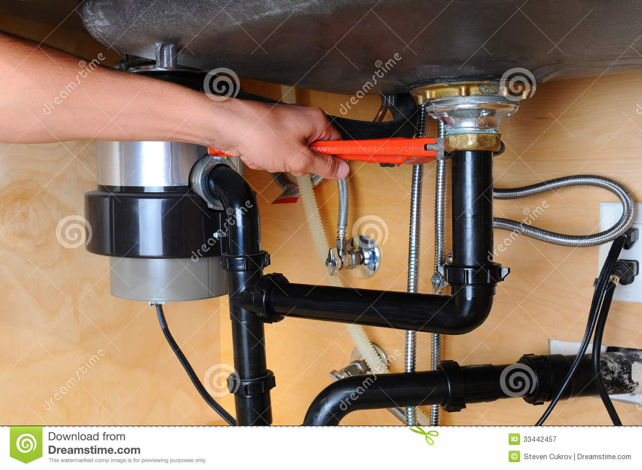 Plumber Using Wrench Under Kitchen Sink Royalty Free Stock Photography Image 33442457