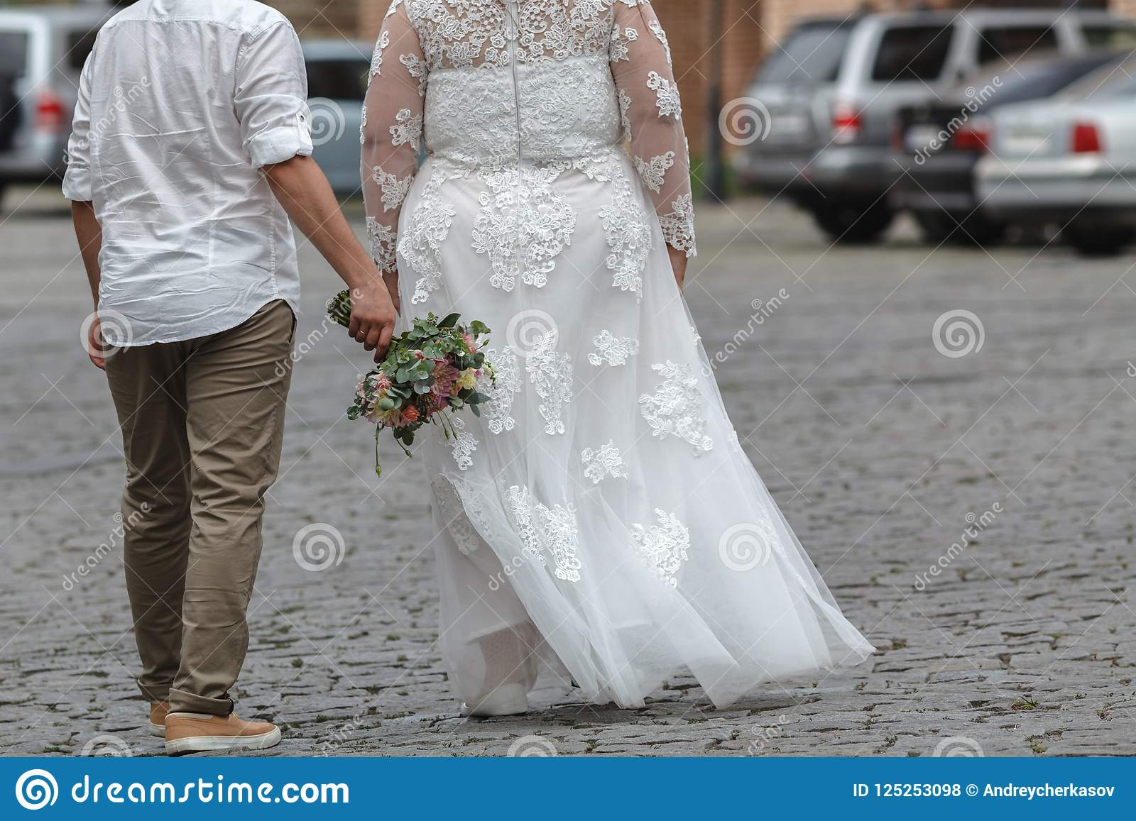Plus Size Bride And Groom With The Bridal Bouquet Stock Photo